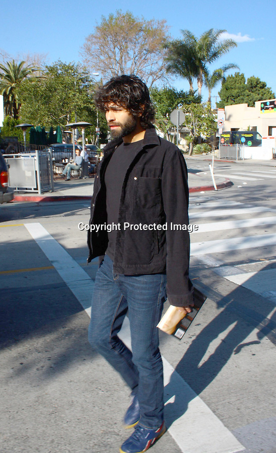2-14-08   Thursday         Exclusive Adrian Grenier with his new black Beard leaving the Earth Cafe in HOllywood. He was reading the The Unusual Suspect book By:. Stephen Baldwin.AbilityFilms@yahoo.com.805-427-3519.www.AbilityFilms.com.