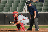Catcher Jesus Sanchez (33) of the Lakewood BlueClaws and home plate umpire Matthew Pridemore at Fieldcrest Cannon Stadium in Kannapolis, NC, Sunday, May 11, 2008.