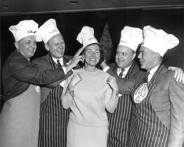 UNITED STATES: Congresswoman Charlotte Reid, R-IL, is capped in the Congressional Chowder and Munching club. Reporters believe this photo was taken between 1965 and 1969. From left to right: Bob Wilson, R-CA, Gerald Ford, R-MI, Charlotte Reid, R-IL, Melvin Laird, R-Wisc., and John Byrnes, R-Wisc. (CQ Roll Call File Photo)