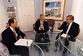 United States President Bill Clinton, center, meets with Chief of Staff Erskine Bowles, left, and National Security Advisor Sandy Berger, right, in the Residence of the White House in Washington, DC on August 17, 1998.<br /> Mandatory Credit:  Ralph Alswang / White House via CNP