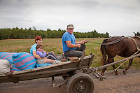 Polish family going to market in a horse drawn wagon. Zawady Central Poland