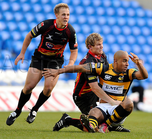 12.12.2010 Heineken Cup Rugby Newport Gwent Dragons v London Wasps. Newport Gwent Dragons Full Back (#15) Patrick Leach tackles London Wasps Winger (#14) Tom Varndell in the second half