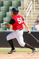 Leighton Pangilinan #51 of the Kannapolis Intimidators follows through on his swing against the Hickory Crawdads at CMC-Northeast Stadium on April 8, 2012 in Kannapolis, North Carolina.  The Intimidators defeated the Crawdads 12-11.  (Brian Westerholt/Four Seam Images)