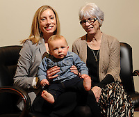 NWA Democrat-Gazette/ANDY SHUPE<br /> Katy Garner (left), her son, Jack, and her mother, Lynn Carver, pose Thursday, Feb. 4, 2016, at Garner's office in Fayetteville. Garner and Carver, along with Garner's mother-in-law, Denise Garner, volunteer to help organize the annual Soup Sunday which benefits Arkansas Advocates for Children and Families.