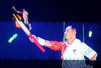 Aug. 8, 2008; Beijing, CHINA; China gold medal winner Sun Jinfang is raised to the roof to light the Olympic torch during the opening ceremonies for the 2008 Beijing Olympic Games at the National Stadium. Mandatory Credit: Mark J. Rebilas-