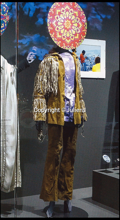 BNPS.co.uk (01202 558833)Pic: Juliens/BNPS<br /> <br /> Mitchell's Henrix era fringed jacket, tie die T-shirt and low-waisted trousers worn by Mitchell in the 1960s.<br /> <br /> An enormous collection of items belonging to the late drummer Mitch Mitchell has emerged for sale.<br /> <br /> The star, who died at the age of 67 in 2008, was best known for his work with Jimmy Hendrix Experience between 1966 and 1970.<br /> <br /> Now his family have decided to sell a large amount of his personal items as they feel they can no longer handle the responsibility and want to see them go to a good home.<br /> <br /> The collection is made up of countless instruments, shirts, posters and documents - many of which are previously unseen.<br /> <br /> The items offer a gateway to a different time with some incredibly outlandish and psychedelic lots perfectly encapsulating London in the 60s.<br /> <br /> Among them is a multi coloured, patchwork shaggy coat which Mitchell would often wear to parties.<br /> <br /> The coat hangs below the waist and looks more like a rug from Austin Powers front room than a sophisticated dinner jacket.