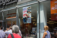 Back to school specials are advertised outside a Payless shoe store in Herald Square in New York on Friday, August 2, 2013. The back to school shopping season is the second busiest time for retailers after Christmas. (© Richard B. Levine)