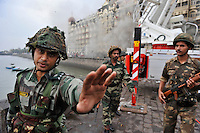 Indian soldiers in front of the Taj Mahal Hotel during the final gun battle between the Indian commandos and  militants inside the hotel in the early hours of 29th of November 2008 in Mumbai, India.