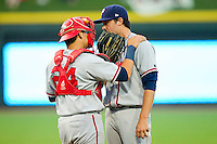 Potomac Nationals catcher Erick Fernandez #24 has a chat on the mound with pitcher Robbie Ray #34 during the Carolina League game against the Winston-Salem Dash at BB&T Ballpark on June 13, 2012 in Winston-Salem, North Carolina.  The Dash defeated the Nationals 5-3.  (Brian Westerholt/Four Seam Images)