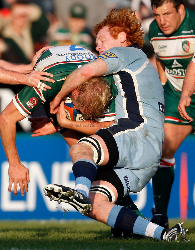 Photo: Richard Lane/Richard Lane Photography..Leicester Tigers v Cardiff Blues. EDF Energy Cup. 03/11/2007. .Blues' Paul Tito tackles Tigers' Lewis Moody.