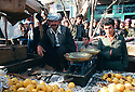 Iran 1979.Sale of fruits in the streets of Mahabad