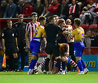 A scuffle breaks out towards the end of the game, which resulted in Lincoln City's Michael O'Connor being shown a red card by referee Ross Joyce<br /> <br /> Photographer Chris Vaughan/CameraSport<br /> <br /> The EFL Checkatrade Trophy Group H - Lincoln City v Mansfield Town - Tuesday September 4th 2018 - Sincil Bank - Lincoln<br />  <br /> World Copyright © 2018 CameraSport. All rights reserved. 43 Linden Ave. Countesthorpe. Leicester. England. LE8 5PG - Tel: +44 (0) 116 277 4147 - admin@camerasport.com - www.camerasport.com