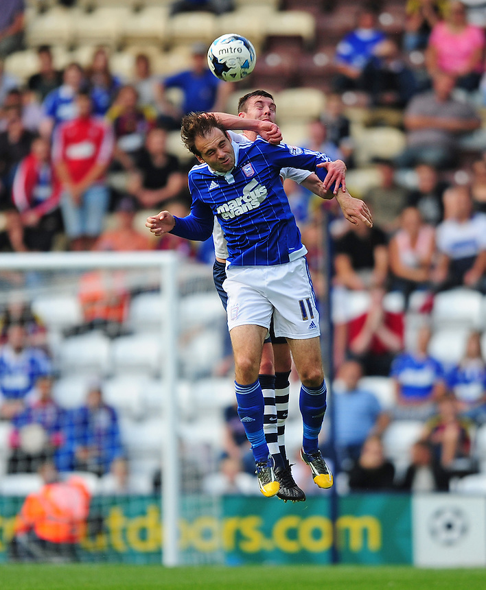 Preston North End's Paul Huntington vies for possession with Ipswich Town's Brett Pitman<br /> <br /> Photographer Chris Vaughan/CameraSport<br /> <br /> Football - The Football League Sky Bet Championship - Preston North End v Ipswich Town - Saturday 22nd August 2015 - Deepdale - Preston<br /> <br /> &copy; CameraSport - 43 Linden Ave. Countesthorpe. Leicester. England. LE8 5PG - Tel: +44 (0) 116 277 4147 - admin@camerasport.com - www.camerasport.com