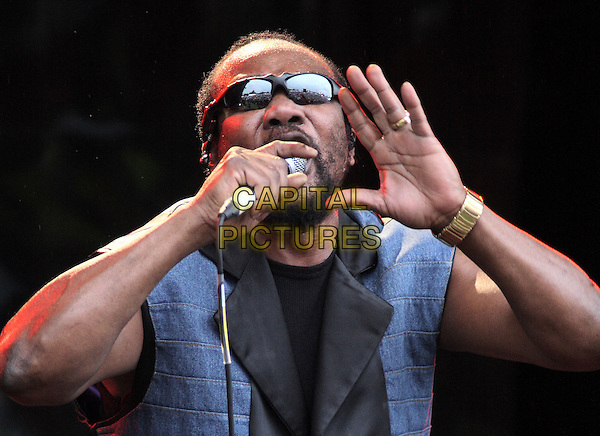 TOOTS & THE MAYTALS .Cornbury Music Festival near Charlbury, Oxford.July 6th 2008.stage concert live gig performance music half length microphone singing blue black top sunglasses shades hand palm .CAP/JIL.©Jill Mayhew/Capital Pictures