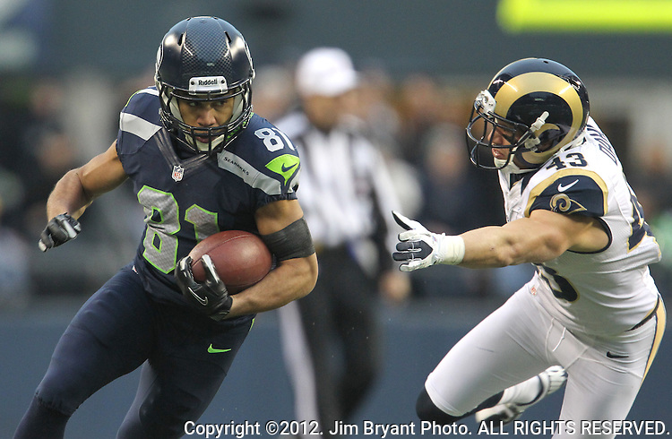 Seattle Seahawks Golden Tate catches a Russell Wilson pass against the  Louis Rams safety Craig Dahl after catching an 18-yard pass from quarterback Russell Wilson at CenturyLink Field in Seattle, Washington on December 30, 2012.   Tate caught four passes for 105 yards in the Seahawks 20-13 come from behind win over the Rams.    © 2012. Jim Bryant Photo. All Rights Reserved.