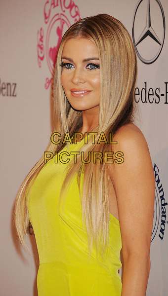 Carmen Electra.The 26th Anniversary Carousel Of Hope Ball presented by Mercedes-Benz at The Beverly Hilton Hotel in Beverly Hills, California, USA..October 20th, 2012.half length yellow dress  .CAP/ROT/TM.©Tony Michaels/Roth Stock/Capital Pictures