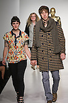 Senior fashion designer Emma Rowe, walks runway with model, at the close of the Pratt 2011 fashion show.