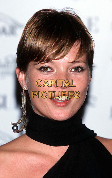 KATE MOSS..Vogue And Jaguar Fashion Fundraising Gala..Ref:10899..neck scarf, short cropped hair, one earring, dangling,  headshot, portrait..www.capitalpictures.com..sales@capitalpictures.com..©Capital Pictures