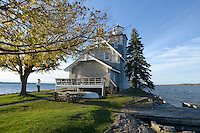 The late autumn morning sun shows off the tidy limestone lighthouse built on the easternmost of the Three Sisters Islands in 1870. It is located in the 1000 Islands of the St. Lawrence River a few miles downstream of Alexandria Bay, New York State.
