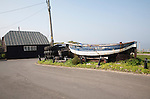 Old fishing boat and fisherman's sheds, Overstrand, Norfolk, England