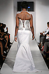 """Model walks runway in an Bridal gown from the Jewel Shannon """"Island Pearl"""" collection, during BK Fashion Weekend Fall Winter 2012."""