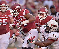 STAFF PHOTO BEN GOFF  @NWABenGoff -- 09/20/14 <br /> Arkansas running back Jonathan Williams breaks the tackle of Northern Illinois defenders Rasheen Lemon (9) and Donovan Gordon (94) on his way to a touchdown during the first quarter of the game against Northern Illinois in Reynolds Razorback Stadium in Fayetteville on Saturday September 20, 2014.