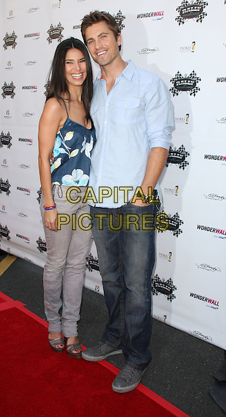 ROSELYN SANCHEZ & ERIC WINTER.Kids with Cancer Press Conference held at the Glendale Galleria, Glendale, California, USA..March 31st, 2009.full length blue shirt jeans denim grey gray pattern top married husband wife.CAP/ADM/KB.©Kevan Brooks/AdMedia/Capital Pictures.