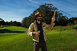 Coyote (Canis latrans) biologist, Jonathan Young, using telemetry to track male on golf course, Presidio Golf Course, Presidio, San Francisco, Bay Area, California