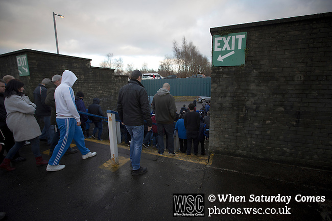 Greenock Morton 2 Stranraer 0, 21/02/2015. Cappielow Park, Greenock. Home supporters heading for the exit at the end of the game between Greenock Morton and Stranraer in a Scottish League One match at Cappielow Park, Greenock. The match was between the top two teams in Scotland's third tier, with Morton winning by two goals to nil. The attendance was 1,921, above average for Morton's games during the 2014-15 season so far. Photo by Colin McPherson.
