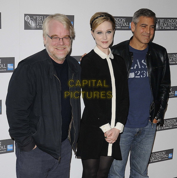 Philip Seymour Hoffman, Evan Rachel Wood and George Clooney.Photocall ahead of the The 55th BFI London Film Festival screening of 'The Ides Of March', Odeon West End, London, England..October 19th 2011.LFF half length black jacket dress jeans denim blue t-shirt boots beard facial hair glasses leather white collar.CAP/CAN.©Can Nguyen/Capital Pictures.