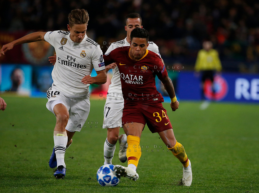 Marcos Llorente of Real Madrid  and Justin Kluivert of AS Roma  during the Champions League Group  soccer match between AS Roma - Real Madrid  at the Stadio Olimpico in Rome Italy 27 November 2018