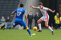 Callum Brittain of MK Dons (right) on the ball under pressure from Andy Barcham of AFC Wimbledon during the Sky Bet League 1 match between MK Dons and AFC Wimbledon at stadium:mk, Milton Keynes, England on 13 January 2018. Photo by David Horn.