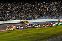 Todd Bodine (#11) leads teammates John King (#7) and Timothy Peters (#17) as Johnny Sauter (#13) hits the wall in the tri-oval.