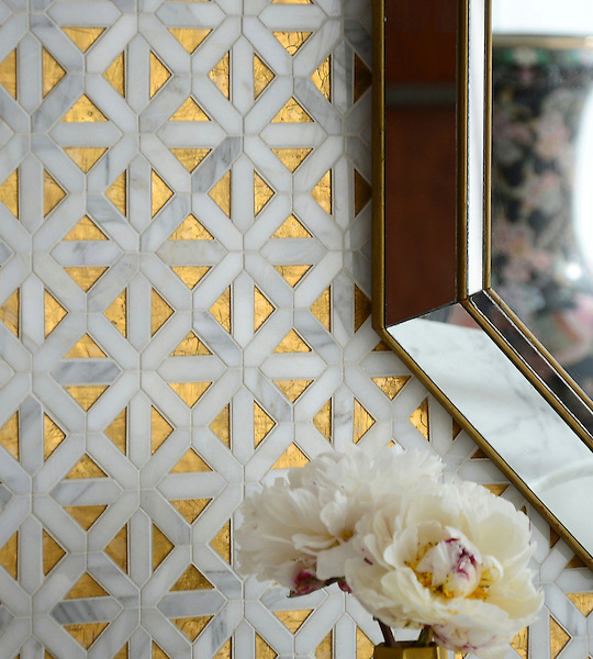 Joie, a handmade mosaic shown in honed 24K Gold Glass, honed Honey Onyx and polished Calacatta, is part of the Aurora&trade; Collection by Sara Baldwin for New Ravenna.<br />