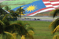Venezuelian Pastor Maldonado on Williams Renault W34 followed by Russian Vitaly Petrov on Caterham Renault CT01.24/03/2012 Grand Prix Malesia, Sepang , Essais..Foto Insidefoto  /Bernard Asset / Panoramic.ITALY ONLY..