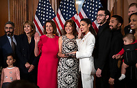 United States Representative Alexandria Ocasio-Cortez (Democrat of New York) poses for a mock swearing-in photo with Speaker of the US House of Representatives Nancy Pelosi (Democrat of California) and members of her family as the 116th Congress convenes for its opening session in the US Capitol in Washington, DC on Thursday, January 3, 2019. Photo Credit: Ron Sachs/CNP/AdMedia