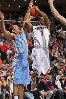 Virginia Cavaliers guard Jontel Evans (1) shoots next to North Carolina Tar Heels guard Kendall Marshall (5) during the game in Charlottesville, Va. North Carolina defeated Virginia 54-51.