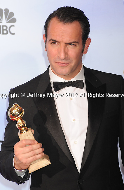 BEVERLY HILLS, CA - JANUARY 15: Jean Dujardin poses in the press room at the 69th Annual Golden Globe Awards held at the Beverly Hilton Hotel on January 15, 2012 in Beverly Hills, California.