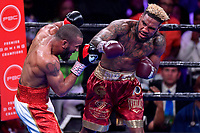 """Fairfax, VA - May 11, 2019: Jarrett """"Swift"""" Hurd connects with an overhand right during Jr. Middleweight title fight at Eagle Bank Arena in Fairfax, VA. Julian Williams defeated Hurd to take home the IBF, WBA and IBO Championship belts by unanimous decision. (Photo by Phil Peters/Media Images International)"""