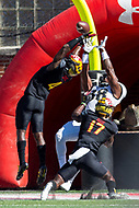 College Park, MD - SEPT 23, 2017: UCF Knights tight end Jordan Akins (88) attempts to catch a pass in double coverage by Maryland Terrapins defensive back Darnell Savage Jr. (4) and Maryland Terrapins defensive back Tino Ellis (17) during game between Maryland and UCF at Capital One Field at Maryland Stadium in College Park, MD. (Photo by Phil Peters/Media Images International)
