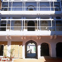 The apartments in this small 18th century Indian palace open via double doors leading onto a walkway which overlooks the central courtyard