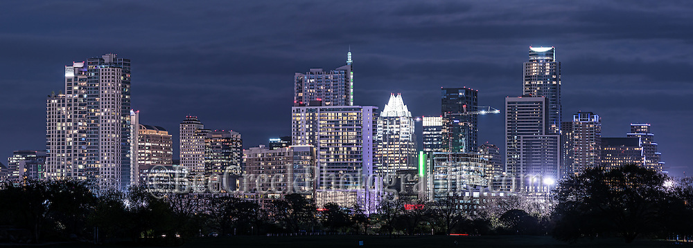 This is an image of the Austin skyline at night with all the buildings lit up on a cloudy evening.  This cityscape shows the latest skyline of the city downtown as the high rise buildings are all lit up with their lights on.  You can still the frost and the 360 Condo alongs with the Austonian along with many new skyscrapers in our city.