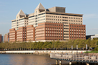 Part of the Hoboken, NJ waterfront redevelopment including the Hoboken Waterfront Corporate Center I and II, a mixed-use office/retail building, with Pier C Park in the foreground