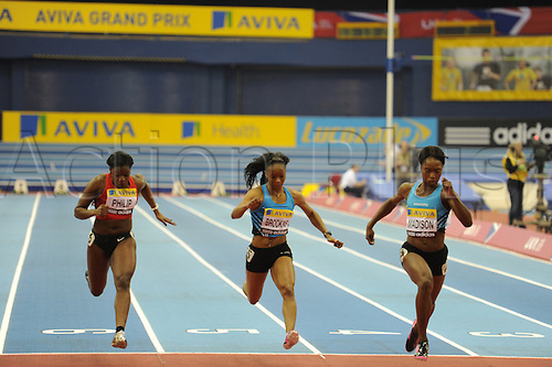 18.02.2012. Birmingham NIA, England.  60 meters sprint for women. Tianna Madison (USA), Kakya Brookins (USA) and Asha Philip (GBR) in action during the Aviva Grand Prix being held at the National Indoor Arena. ...