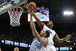 31 December 2013: UNC Wilmington's Cedrick Williams (behind) blocks a shot by North Carolina's James Michael McAdoo (43). The University of North Carolina Tar Heels played the UNC Wilmington Seahawks at the Dean E. Smith Center in Chapel Hill, North Carolina in a 2013-14 NCAA Division I Men's Basketball game. UNC won the game 84-51.