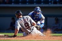 Mesa Solar Sox catcher Willson Contreras (40) tags out Mike Gerber (9) sliding into home during an Arizona Fall League game against the Scottsdale Scorpions on October 19, 2015 at Sloan Park in Mesa, Arizona.  Scottsdale defeated Mesa 10-6.  (Mike Janes/Four Seam Images)