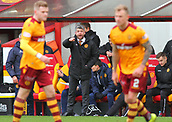 18th March 2018, Fir Park, Motherwell, Scotland; Scottish Premiership football, Motherwell versus Celtic;  Stephen Robinson give reorganisation instructions to his side after the red card for Cedric Kipre
