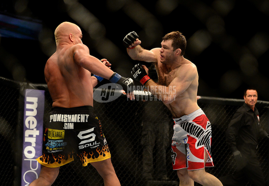 Jul. 7, 2012; Las Vegas, NV, USA; UFC fighter Forrest Griffin (right) against Tito Ortiz during a light heavyweight bout in UFC 148 at the MGM Grand Garden Arena. Mandatory Credit: Mark J. Rebilas-