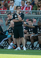 23 June 2011: Toronto FC head coach Paul Mariner watches the action during an MLS game between the New England Revolution and the Toronto FC at BMO Field in Toronto.