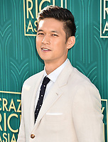 HOLLYWOOD, CA - AUGUST 07: Harry Shum Jr. arrives at the Warner Bros. Pictures' 'Crazy Rich Asians' premiere at the TCL Chinese Theatre IMAX on August 7, 2018 in Hollywood, California.<br /> CAP/ROT/TM<br /> &copy;TM/ROT/Capital Pictures
